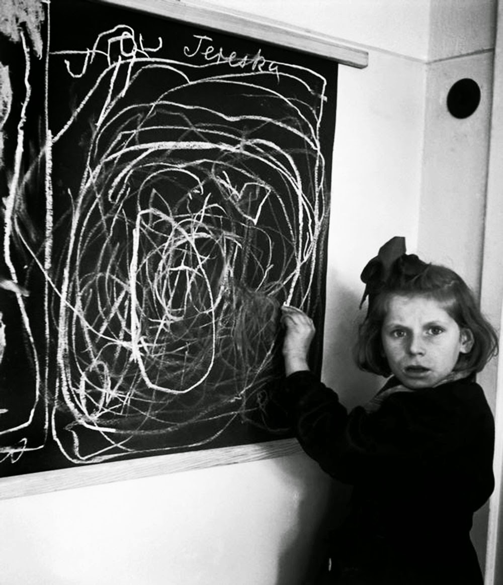 A girl who grew up in a concentration camp draws a picture of home while living in a residence...jpg