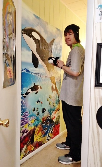 Tim with his wall decoration.jpg